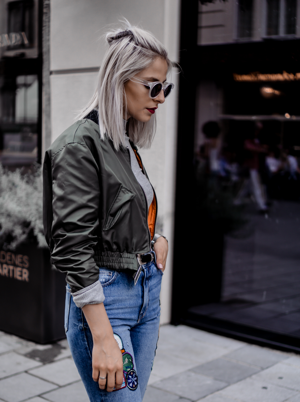 The Cosmopolitas Outfit: Mom Jeans and Bomber Jacket